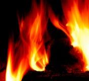 Lèchement des flammes Images libres de droits