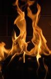 Lèchement des flammes Image stock