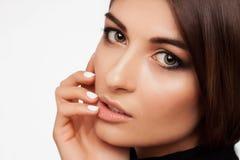 Lèvres et yeux de beauté de femme dans le studio Images libres de droits