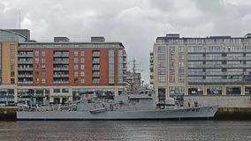 Military ship in fron to pqrtment buildings in the city of Dublin. LÉ Ciara P42, high speed military ship in fron to pqrtment buildings in Lieffey river in stock photography