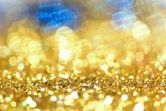 Or léger d'or abstrait de fond de Bokeh Photos stock