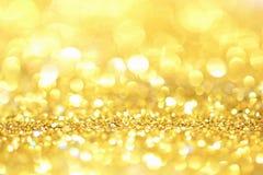 Or léger d'or abstrait de fond de Bokeh Photographie stock