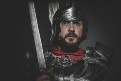 Légionnaire romain spartiate et prétorien et manteau, armure et swo rouges Photo libre de droits