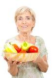 Légumes aînés heureux de fixation de femme Photographie stock