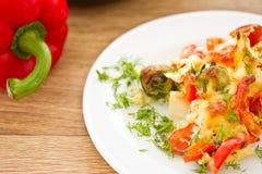 Légumes cuits au four avec du fromage Images libres de droits