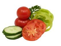 Légumes découpés en tranches frais. D'isolement. Images libres de droits