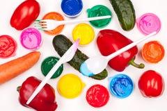 Légumes et peintures de couleur Photo stock