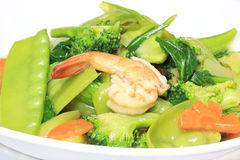 Légumes faits sauter à feu vif avec la fourchette image libre de droits