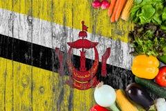 L?gumes frais du Brunei sur la table Cuisson du concept sur le fond en bois de drapeau photo libre de droits