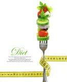 Légumes sur la fourchette avec la bande de mesure image stock