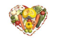 Légumes mélangés sur la forme de coeur Photographie stock libre de droits