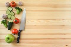 Légumes sur le fond en bois Photos stock