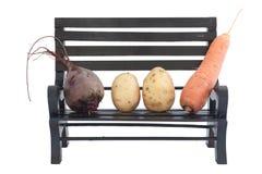 Légumes sur un banc Photos stock