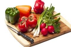 Légumes sur un bord de kitcken Photos libres de droits