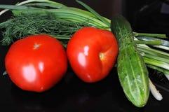 Légumes sur un fond noir Photographie stock libre de droits