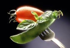 Légumes sur une fourchette photo stock