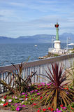 Léman lake at Evian in France. Little garden and lighthouse at Evian-les-Bains on the banks of Léman lake to the east of France, commune in the Haute-Savoie Royalty Free Stock Photo