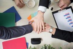 Líderes de negócio que juntam-se às mãos Fotografia de Stock Royalty Free