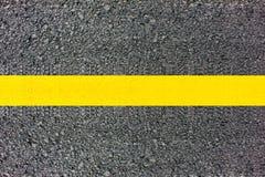 Línea amarilla de la textura del camino Imagen de archivo