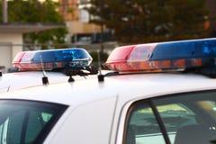 Línea de 2 sirenas de policía Fotos de archivo libres de regalías