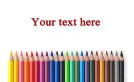 Línea de lápices coloreados con el lugar para el texto Foto de archivo