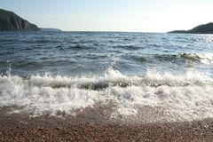 Línea de la playa de la bahía de la mujer mayor Foto de archivo