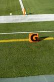 Línea de meta americana etiqueta de plástico del balompié del NFL del momento del aterrizaje foto de archivo