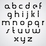 Línea de puntos fuente intrépida del monocromo con las letras minúsculas redondeadas Foto de archivo libre de regalías