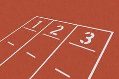 Línea de salida en la arcilla roja Fotografía de archivo libre de regalías