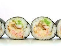 Línea de sushi Rolls Imagen de archivo libre de regalías