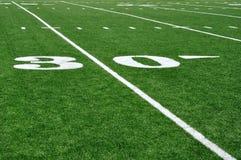 Línea de yardas 30 en campo de fútbol americano Imágenes de archivo libres de regalías