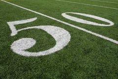 Línea de yardas del fútbol americano cincuenta Imagen de archivo libre de regalías
