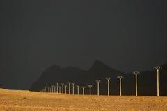 Línea eléctrica en el postre Fotografía de archivo