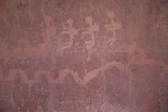 Línea figuras del baile en arte de la roca Foto de archivo