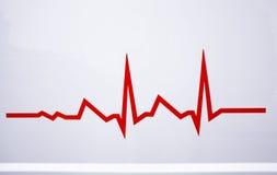Línea roja del electrocardiograma Foto de archivo libre de regalías