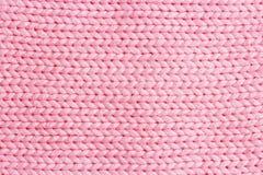 Línea vertical rosada fondo de la textura de la tela que hace punto o hecho punto Foto de archivo libre de regalías