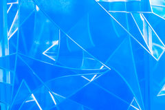 Líneas abstractas y figuras hechas del vidrio azul Foto de archivo libre de regalías