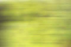 Líneas amarillas verdes de la falta de definición de movimiento del fondo de la pendiente fotos de archivo libres de regalías