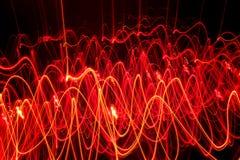 Líneas de fuego abstractas que forman diversas formas Imagen de archivo libre de regalías