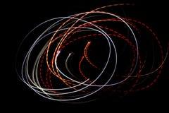 Líneas de luces en un fondo negro Fotografía de archivo libre de regalías