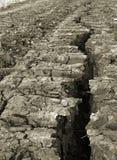 Líneas duras - fractura en tierra imagenes de archivo