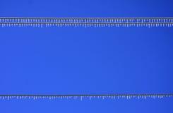 Líneas eléctricas del hielo Imágenes de archivo libres de regalías