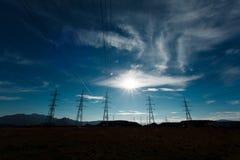 Líneas eléctricas del voltaje Foto de archivo libre de regalías