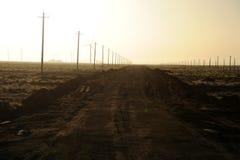 Líneas eléctricas en amanecer Foto de archivo libre de regalías