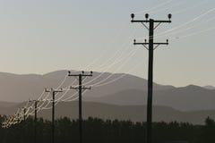 Líneas eléctricas en el campo Fotografía de archivo