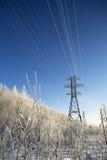 Líneas eléctricas en invierno Fotos de archivo libres de regalías
