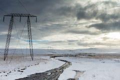 Líneas eléctricas en nieve Foto de archivo