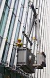 Líquido de limpeza de janela comercial da construção foto de stock