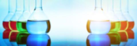 Líquido em umas garrafas do laboratório Imagens de Stock Royalty Free