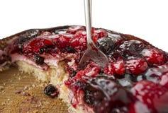Löffel in einem Kuchen stockbild